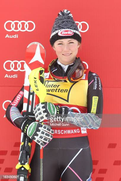 3rd placed racer Mikaela Shiffrin of the USA celebrates on the podium after the Audi FIS Alpine Ski World Cup Women's Slalom on March 10 2013 in...