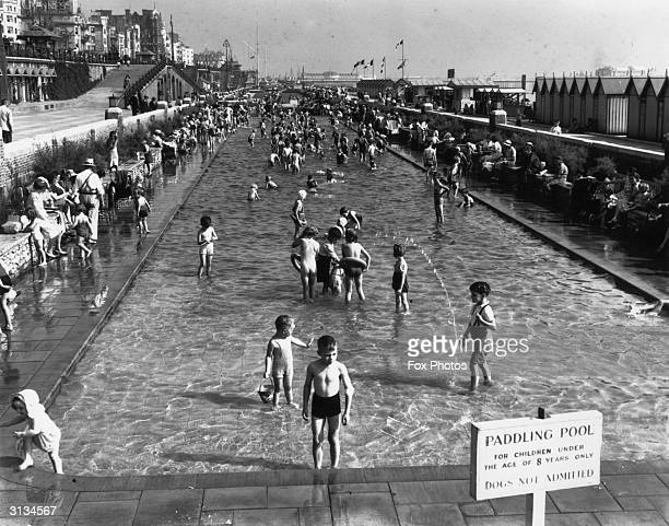 Children play in a paddling pool on Brighton, Sussex sea front on the day Britain declared war on Germany in WW II.