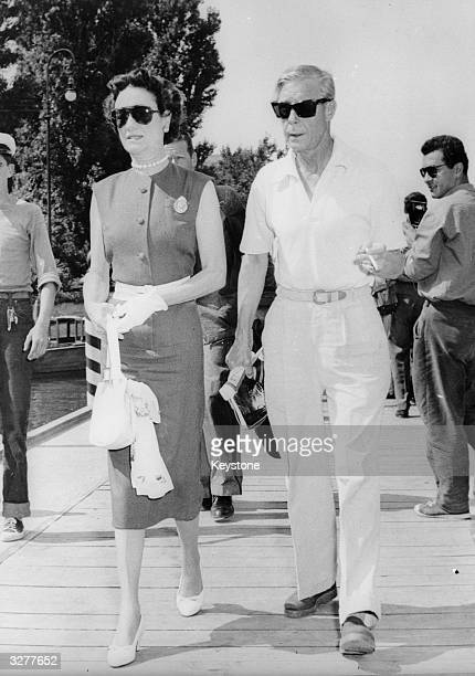 The Duke and Duchess of Windsor take a stroll at the Lido Venice where they are attending the International Film Festival