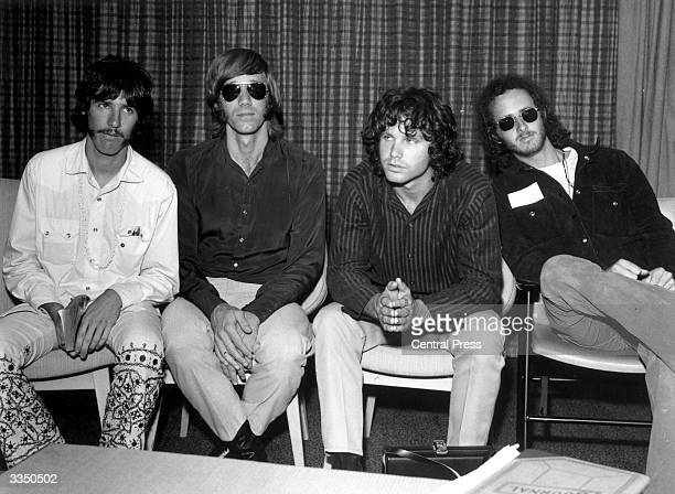 American psychedelic rock band The Doors during a press conference at Heathrow Airport London drummer John Densmore keyboard player Ray Mansarek...