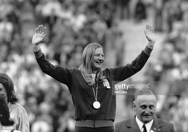 Mary Peters celebrates after receiving the gold medal for the Pentathlon at the 1972 Munich Olympics setting a new world record at the age of 33 of...