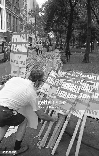 New York City A man grabs a Mondale/Ferraro sign at a rally in downtown Manhattan during the 1984 Presidential race