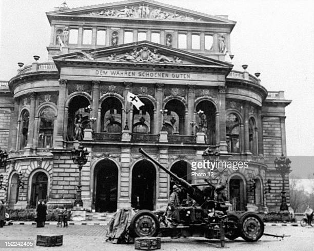 A 3rd US Army antiaircraft gun is shown with its crew in front of the Opera House in Frankfurt onMain The town was cleared of enemy forces March 29...
