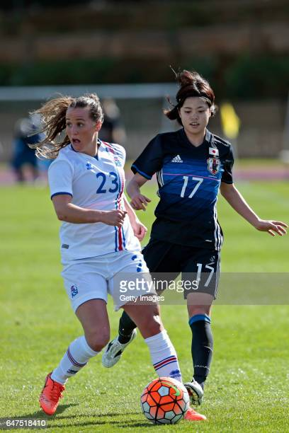 Yui Hasegawa of Japan Women challenges Fanndis Fridriksdottir of Iceland Women during the match between Japan v Iceland Women's Algarve Cup on March...