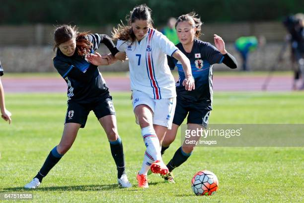 Yuri Kawamura and Rumi Utsugi of Japan Women challenges Sara Bjork Gunnarsdottir of Iceland Women during the match between Japan v Iceland Women's...