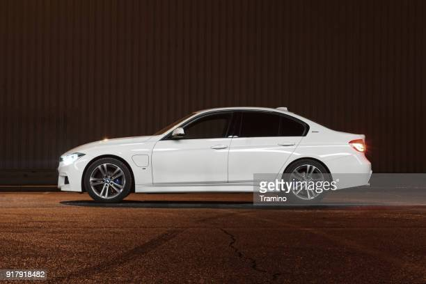 bmw 3-series in plug-in hybrid version at night - bmw stock pictures, royalty-free photos & images