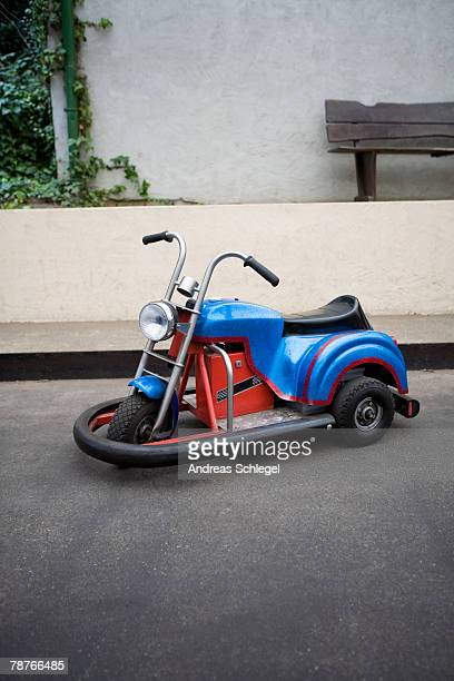 A 3-wheel ride on toy cycle with rubber bumper