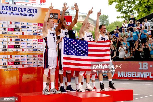 USA 3x3 basketball team celebrates its victory on the podium after deafeating Latvia during the FIBA 3x3 World Cup basketball at the Museumplein in...