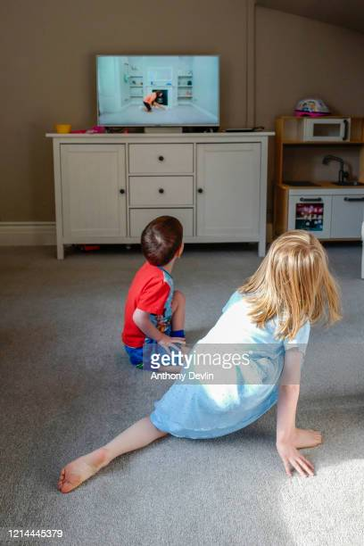 3yearold Alexander James and 5yearold Charlie Rose participate in the Joe Wicks YouTube workout as schools remain closed on March 24 2020 in...