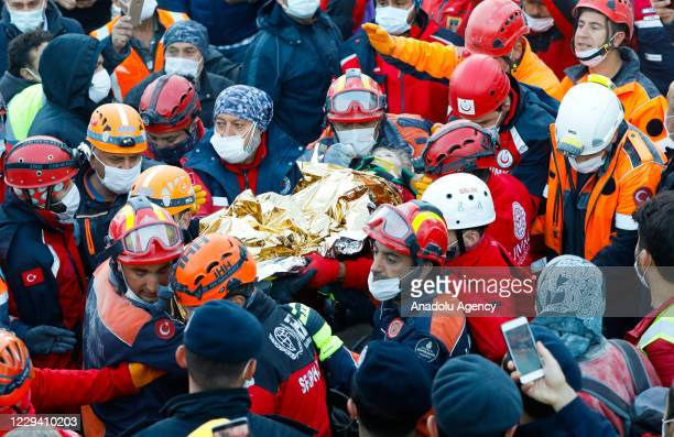 Year-old girl, Elif Perincek, is pulled from the debris 65 hours after a magnitude 6.6 quake shook Turkey's Aegean Sea coast, in Izmir, Turkey on...