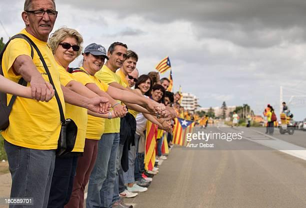 "400km human chain Catalonia rally demonstration Catalunya flag senyera catalan independence freedom referendum row chain ""11 de setembre"" diada 2013..."