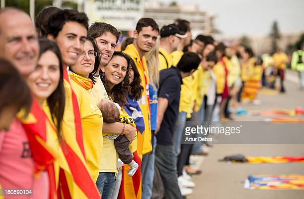 CONTENT] 400km human chain Catalonia rally demonstration Catalunya flag senyera catalan independence freedom referendum row chain 11 de setembre...