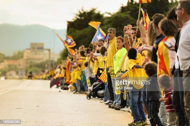 CONTENT] 400km human chain Catalonia rally demonstration Catalunya flag senyera catalan independence freedom referendum row chain 11 de setembre...