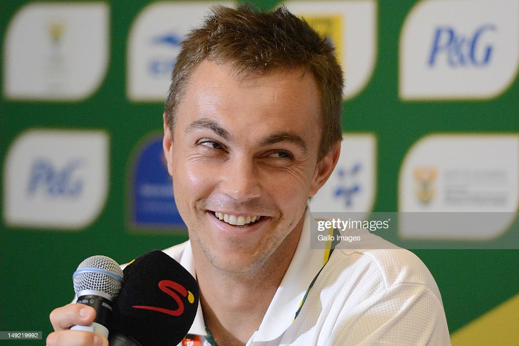 400m hurdler LJ van Zyl smiles during the South African Olympic Team Press Conference from Copthorne Tara Hotel, Kensington on July 25, 2012 in London, England.
