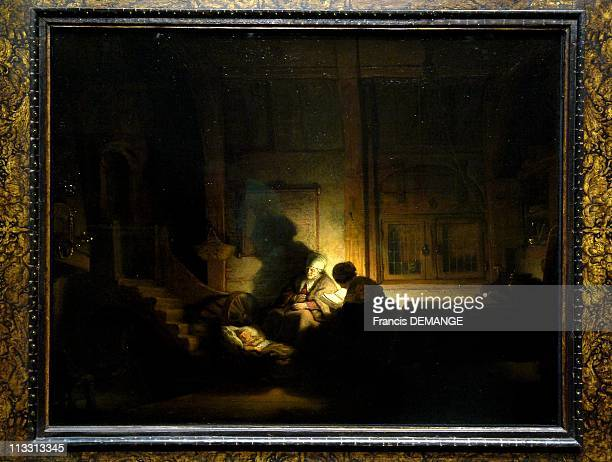 400Th Anniversary Of Dutch Art Master Rembrandt On February 2006 In Amsterdam Netherlands Here The Holy Family At Night By Rembrandt Harmensz Van Rijn
