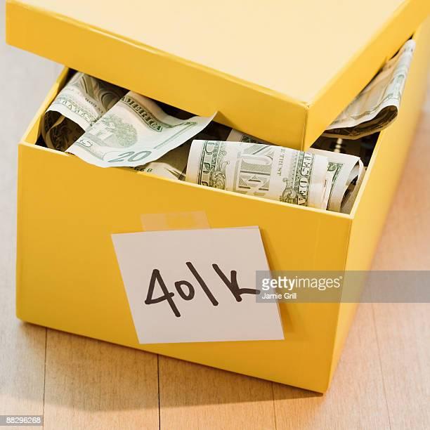 401k box full of paper money