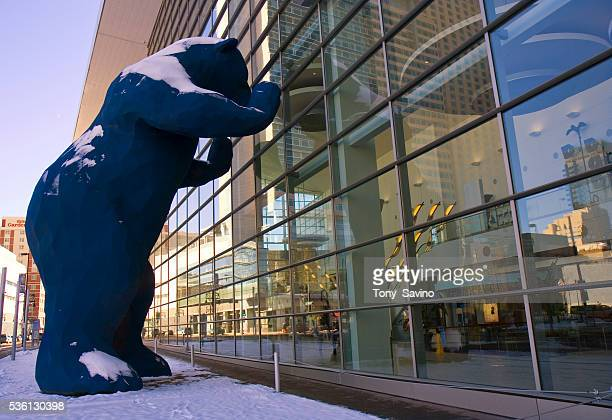 A 40foottall blue bear sculpture designed by Lawrence Argent entitled I See What You Mean peers insde the Colorado Convention Center on 14th Street