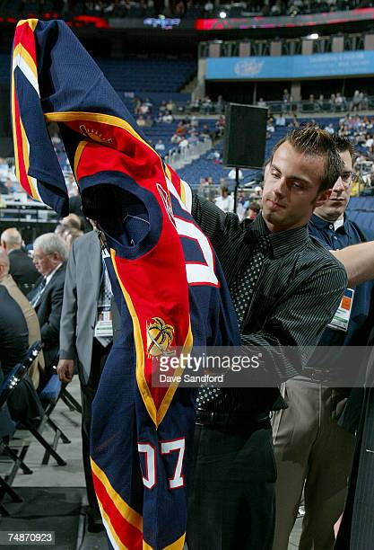 40th overall draft pick Michal Repik of the Florida Panthers puts on his new jersey during the 2007 NHL Entry Draft at Nationwide Arena on June 23...