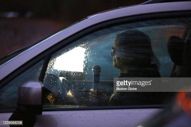 Year member of the church holds the microphone in her car at St. Anne's in-the-Fields Episcopal Church in Lincoln, MA on Nov. 1, 2020. St. Anne's...
