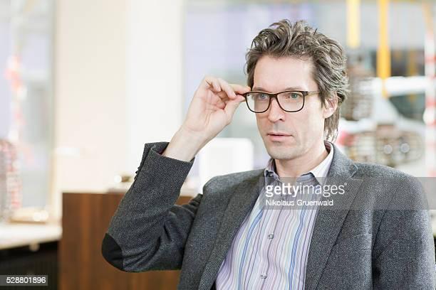 40-year old man selecting new eyewear in an optometrics store