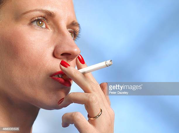 40-year old woman smoking with copy space