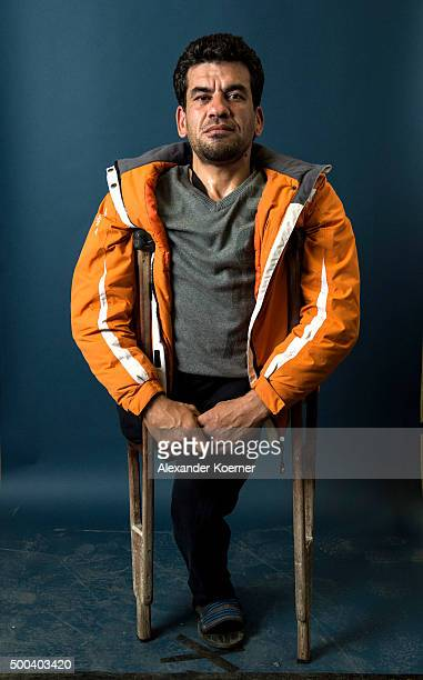 40yearold Bagour Muaid from Idleb Syria poses inside a refugee camp in Sarstedt on November 4 2015 in Sarstedt Germany The refugee camp holds up to...