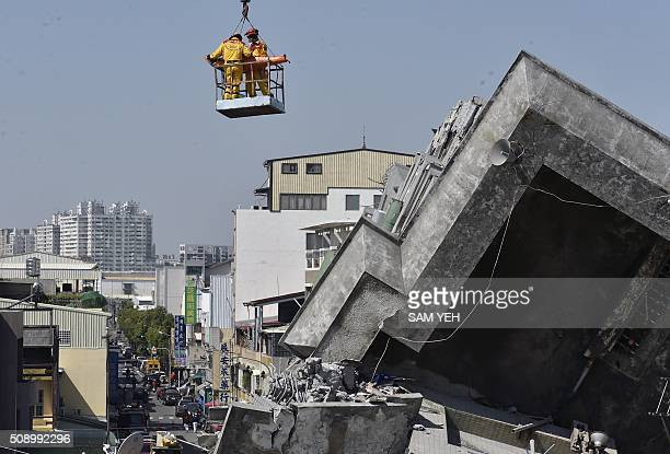 A 40yearold man identified by local media as Lee Tsungtian is lifted by a crane out of the rubble by rescue workers at the WeiKuan complex which...