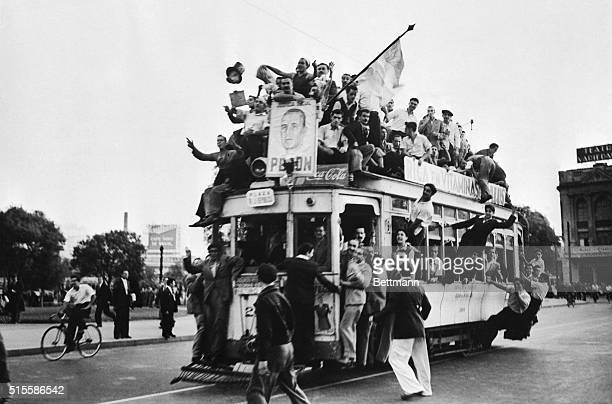 4/10/1946Buenos Aires ArgentinaEnthusiastic Argentines pack every available inch of space inside and outside a trolley in Buenos Aires in celebration...