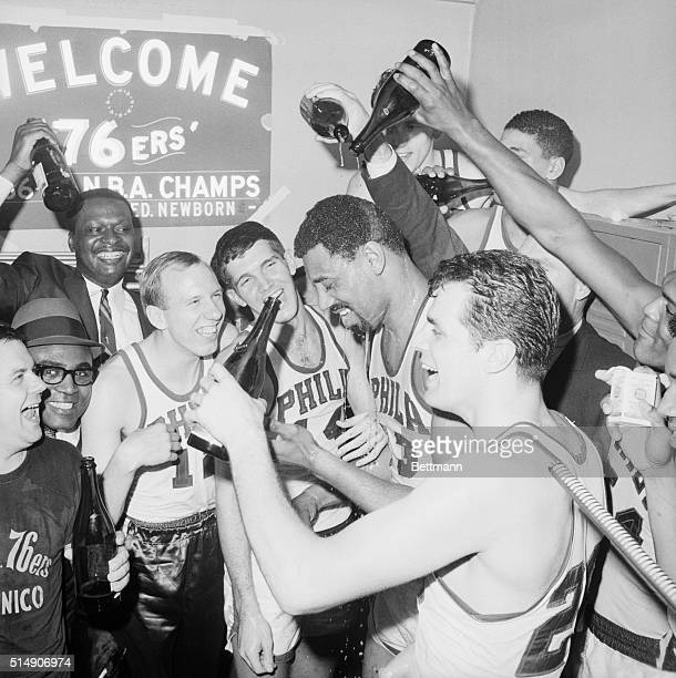 4/11/1967Philadelphia PA After beating the Celtics 140116 for the Eastern NBA title members of the 76ers pour champagne over Wilt Chamberlain In...