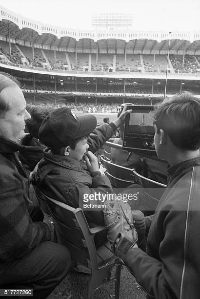 4/11/1970New York NY Tom Swords and Morty Wiggins both 14 have their attention divided between the real fleshandblood YanksIndians game going on in...