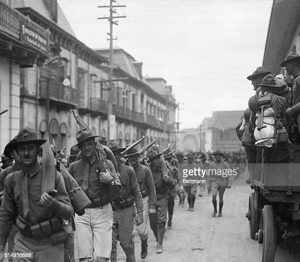 4/1/1931Managua NicaraguaA detachment of US Marines marches through a Managua street going on patrol duty Scenes such as this are now being reenacted...