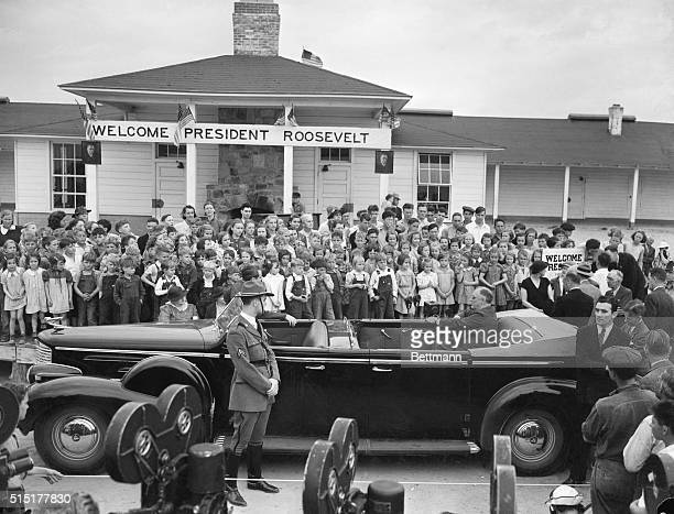 """Warm Springs, CA: President and Mrs. Roosevelt are pictured listening to the strains of """"Happy Days Are Here Again,"""" the Roosevelt campaign song,..."""