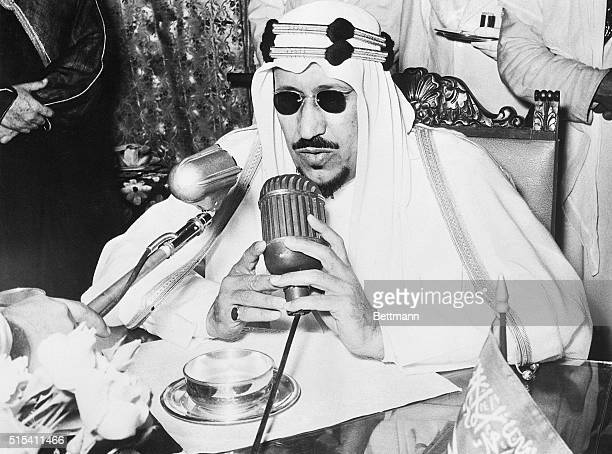 4/12/1956Djeddah Saudi ArabiaArabia's King Saud holds the microphone close to his face as he makes a brief afterlunch address at the Royal Palace...