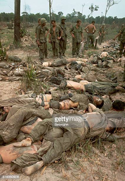 4/12/1968Saigon Vietnam Soldiers of the 25th Infantry Division look at the bodies of more than 50 Viet Cong killed in the Battle of Good Friday 80...
