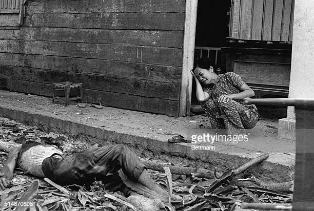 4/12/1975Tay Ninh South Vietnam A South Vietnamese woman cries over the death of her husband after Communist rockets hit this city some 50 miles...