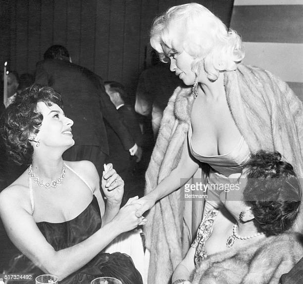 4/12/57Beverly Hills California Italian actress Sophia Loren and glamorous Jayne Mansfield are shown as they met tonight at a gala party in...