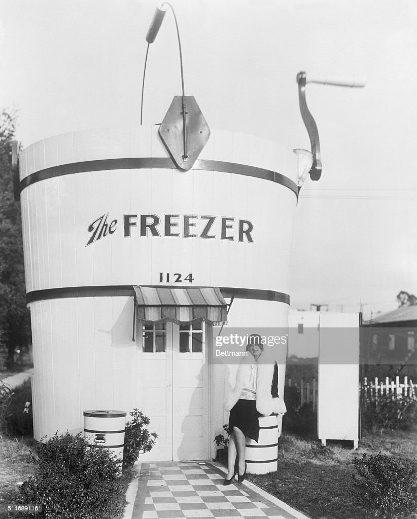 Merchants in Hollywood, California seek self expression in constructing their store to resemble the commodity they sell. In the above photo, Esther Ralston, screen favorite is seen beside unique hut made to resemble a huge ice-cream freezer. The handle on top maintains a continuous movement. BPA2 #5257