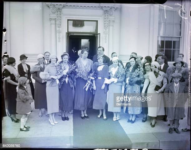 4/13/1933Washington DC Mrs Franklin D Roosevelt is tendered a basket of peach blossoms by these visitors who invited her to the annual Blossom Time...