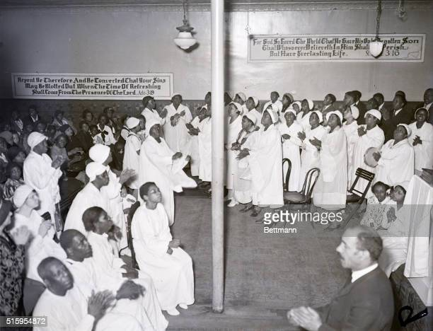 4/13/1934New York NY Hundreds of worshippers thronged the Pentecostal Faith Church of All Nations in Harlem New York April 12 to participate in one...