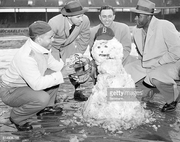 A flatering sun soaked up some of the snow that whitewashed the Brooklyn Dodgers homecoming exhibition tilt with the New York Yankees todaybut too...