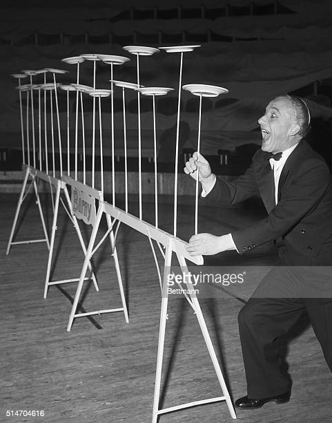 German juggler Barney literally dishes out his act as he performs his multiplate balancing number before a Paris audience He spins dinner plates on...