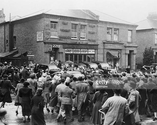 4/1/53London England The crowd gathers around a car leaving the police station in suburban Putney hoping for a glimpse of suspected sex slayer John R...