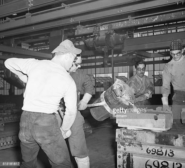 4/16/1941Fair Lawn NJ Workmen pour molten magnesium into a cast which will produce a supercharger for a Wright Cyclone or a Whirlwind motor at the...