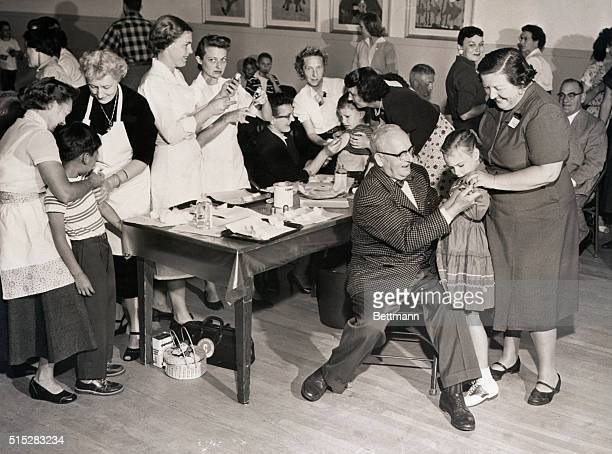 4/16/1955San Diego CA Three people from one family giving polio shots Danny Vasquez gets shot from Dr Virginia Caspe Woman seated in dark dress is Dr...