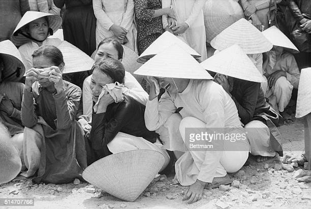 4/16/1969Hue South Vietnam Women grieve for the more than 400 victims of the 1968 Viet Cong Tet offensive whose bodies were found in mass graves...