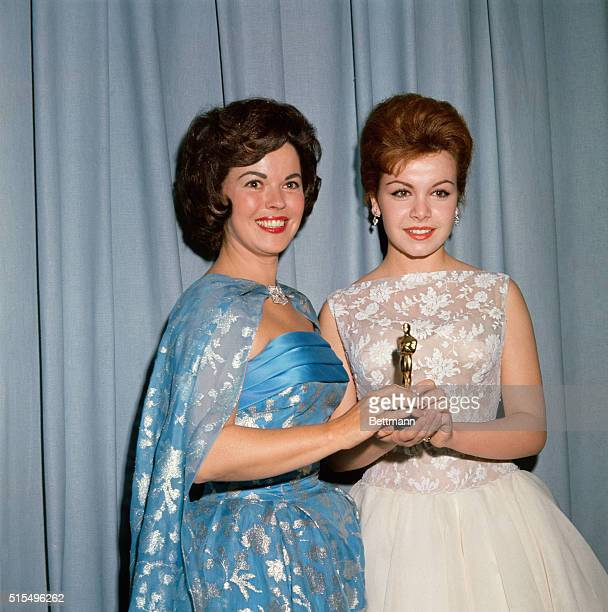 Actress Shirley Temple Black presents Oscar to Annette Funicello during the Award Ceremonies