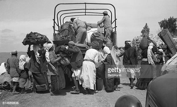 4/18/1948Colonia Palestine Arab villagers evacuate their homes in Colonia as Haganah fighters take over the village in the mountain fighting over the...