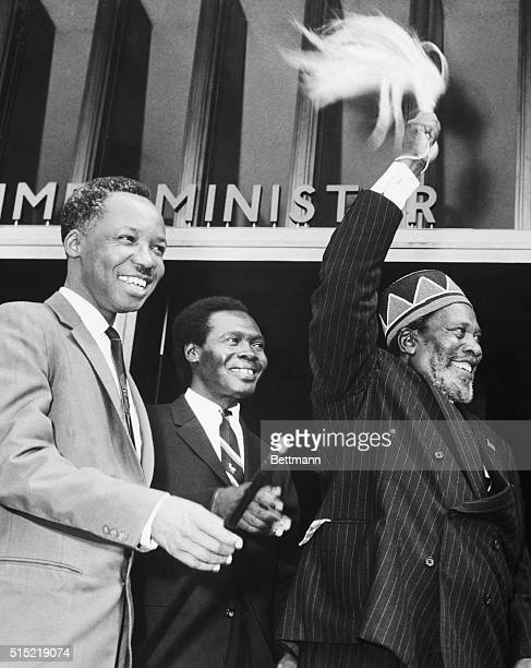 4/18/1964Nairobi Kenya Prime Minister Jomo Kenyatta of Kenya waves his plumed symbol vigorously to a crowd before entering the East African Heads of...
