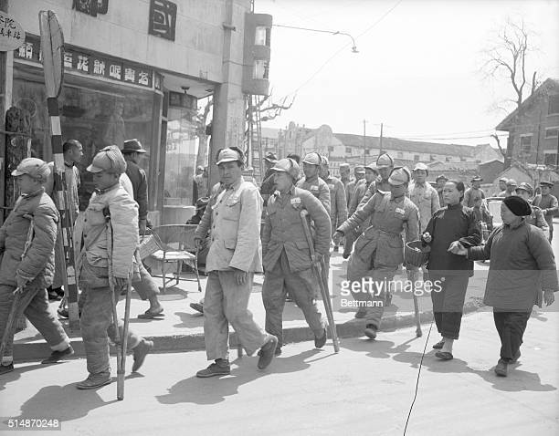 Wounded Nationalist soldiers from the area around Nanking are shown pouring into the city fleeing just ahead of the advancing Communist forces The...