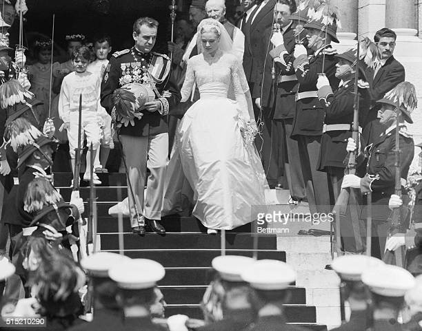 Now man and wife Prince Rainier and his bride American screen star Grace Kelly leave Monaco Cathedral following the brilliant Roman Catholic ceremony...